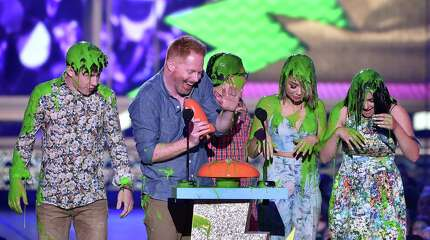 "INGLEWOOD, CA - MARCH 28:  (L-R) Actors Nolan Gould, Jesse Tyler Ferguson, Rico Rodriguez, Sarah Hyland and Ariel Winter get slimed as they accept the award for Favorite Family TV Show for ""Modern Family"" onstage during Nickelodeon's 28th Annual Kids' Choice Awards held at The Forum on March 28, 2015 in Inglewood, California."