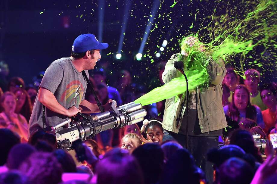 INGLEWOOD, CA - MARCH 28:  Actor Adam Sandler (L) slimes Josh Gad onstage during Nickelodeon's 28th Annual Kids' Choice Awards held at The Forum on March 28, 2015 in Inglewood, California. Photo: Kevin Winter, Getty Images / 2015 Getty Images
