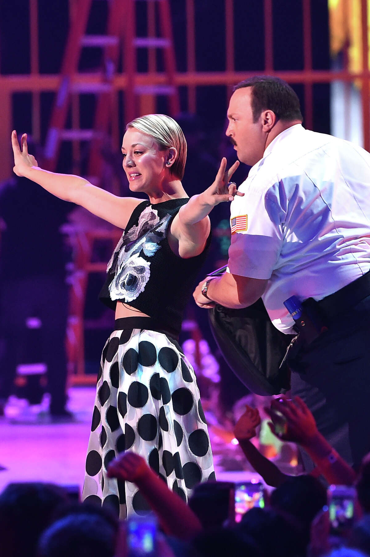 INGLEWOOD, CA - MARCH 28: Actors Kevin James (R) and Kaley Cuoco speak onstage during Nickelodeon's 28th Annual Kids' Choice Awards held at The Forum on March 28, 2015 in Inglewood, California.
