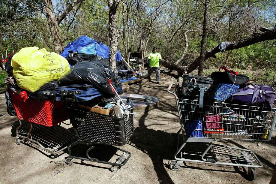 Jackie Webb prepares to leave a tent camp in Fort Worth last week as the city started clearing the area. Activists  took some homeless people to assistance centers or hotels Saturday. The city breaks up between 100 and 150 camps a year Photo: Khampha Bouaphanh, MBI / The Fort Worth Star-Telegram
