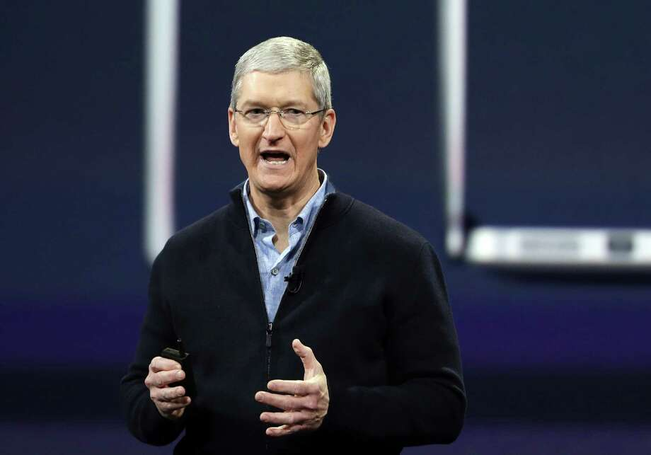 FILE - In this Monday, March 9, 2015, file photo, Apple CEO Tim Cook speaks during an Apple event in San Francisco. Cook is joining a long list of magnates promising to give away most of the wealth that they amass during their careers. Cook mentioned his intentions in a story about him released Thursday, March 26, 2015, by Fortune magazine. After paying for the college education of his 10-year-old nephew, Cook says he will donate the rest of his money to philanthropic causes. (AP Photo/Eric Risberg, File) Photo: Eric Risberg, STF / AP