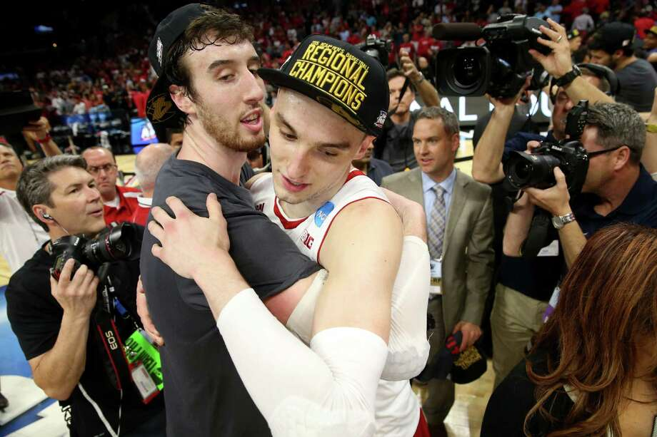 Wisconsin's potent one-two punch of Frank Kaminsky, left, and Sam Dekker celebrate the Badgers' victory over Arizona in the NCAA West Regional final. Photo: Stephen Dunn, Staff / 2015 Getty Images
