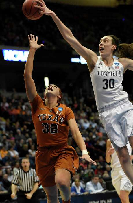 Connecticut's Breanna Stewart (30) swats a shot by Texas' Brady Sanders (32) in the second half of Saturday's Albany Regional semifinal game. Stewart had 31 points, 12 rebounds and seven assists. Photo: Cloe Poisson, MBR / Hartford Courant