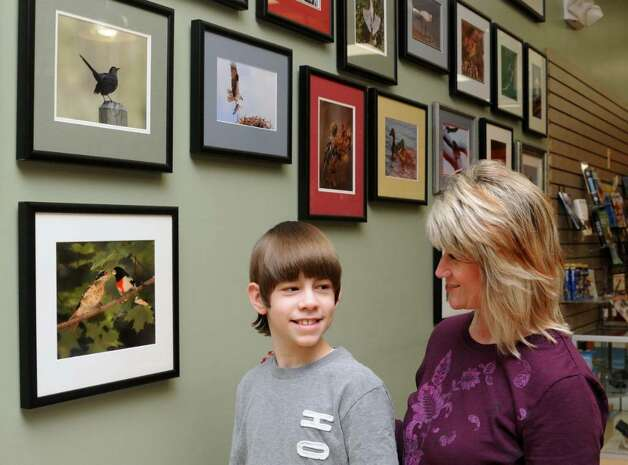 Joey Lounsbury, 13, with his mother, Jill Lounsbury, both of Danbury, CT, at Birds Unlimited, at 317 Federal Rd, Brookfield, CT, where the younger Lounsbury has a display featuring his bird photography, on Wednesday, March 2, 2010. Lounsbury started photographing birds in his backyard when he recieved a camera as a gift. Photo: Jay Weir / The News-Times