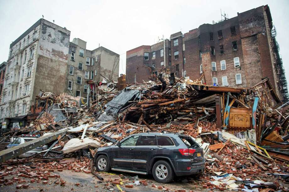 A pile of debris remains at the site of a building explosion in the East Village neighborhood of New York. Investigators have been considering the possibility the blast occurred because of plumbing and gas work. Photo: Nancy Borowick /New York Times / Pool The New York Times