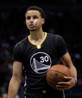 Golden State Warriors guard Stephen Curry gets ready to take a free throw shot against the Milwaukee Bucks during the first half of an NBA basketball game Saturday, March 28, 2015 in Milwaukee. (AP Photo/Darren Hauck)