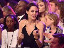 INGLEWOOD, CA - MARCH 28:  (L-R) Zahara Marley Jolie-Pitt, actress Angelina Jolie and Shiloh Nouvel Jolie-Pitt in the audience during Nickelodeon's 28th Annual Kids' Choice Awards held at The Forum on March 28, 2015 in Inglewood, California.  (Photo by Kevin Winter/Getty Images)