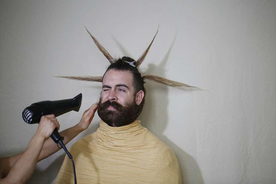 The creators of Incredibeard, Angela Webb and Isaiah Webb manipulate the 17-inch beard into this week's Incredibeard styling, the patron saint of beards, on Sunday March 22, 2015 in San Francisco, Calif. Photo: Mike Kepka, The Chronicle