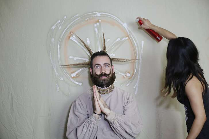 The creators of Incredibeard, Angela Webb and Isaiah Webb put the finishing touches on this week's Incredibeard styling, the patron saint of beards, on Sunday March 22, 2015 in San Francisco, Calif.
