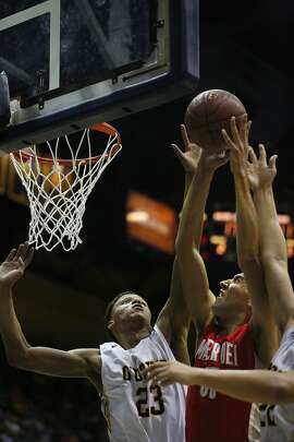 Bishop O'dowd's Ivan Rabb, left, and Alez Zhao, right, play defense as Mater Dei's MJ Cage goes in for a layup during the CIF State Basketball Championships open division boys' game between Mater Dei and Bishop O'Dowd in the Haas Pavilion March 28, 2015 in Berkeley, Calif.