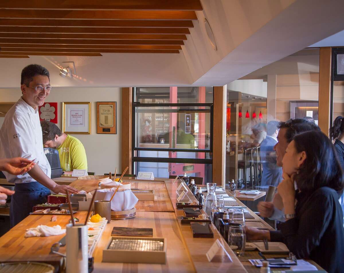 Chef Taka Toshi smiles with guests at Sushi Ran in Sausalito.