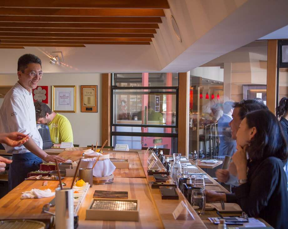 Chef Taka Toshi smiles with guests at  Sushi Ran in Sausalito. Photo: John Storey, Special To The Chronicle