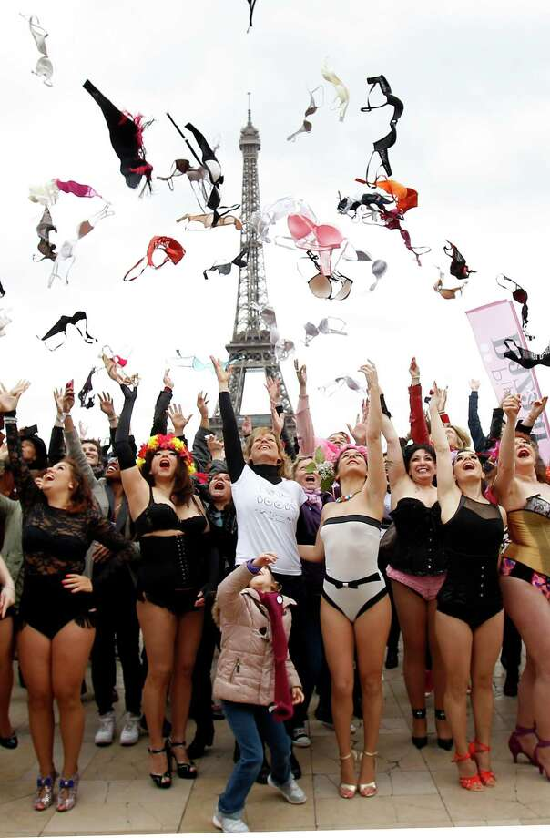 Women throw their bras up in the air during the 6th edition of the Pink Bra Bazaar Rally at Trocadero Square next to the Eiffel tower on March 29, 2015 in Paris, France. Pink Bra Bazaar is a charitable organization that aims to educate about breast health and supports women with breast cancer. Photo: Chesnot, Getty Images / 2015 Chesnot