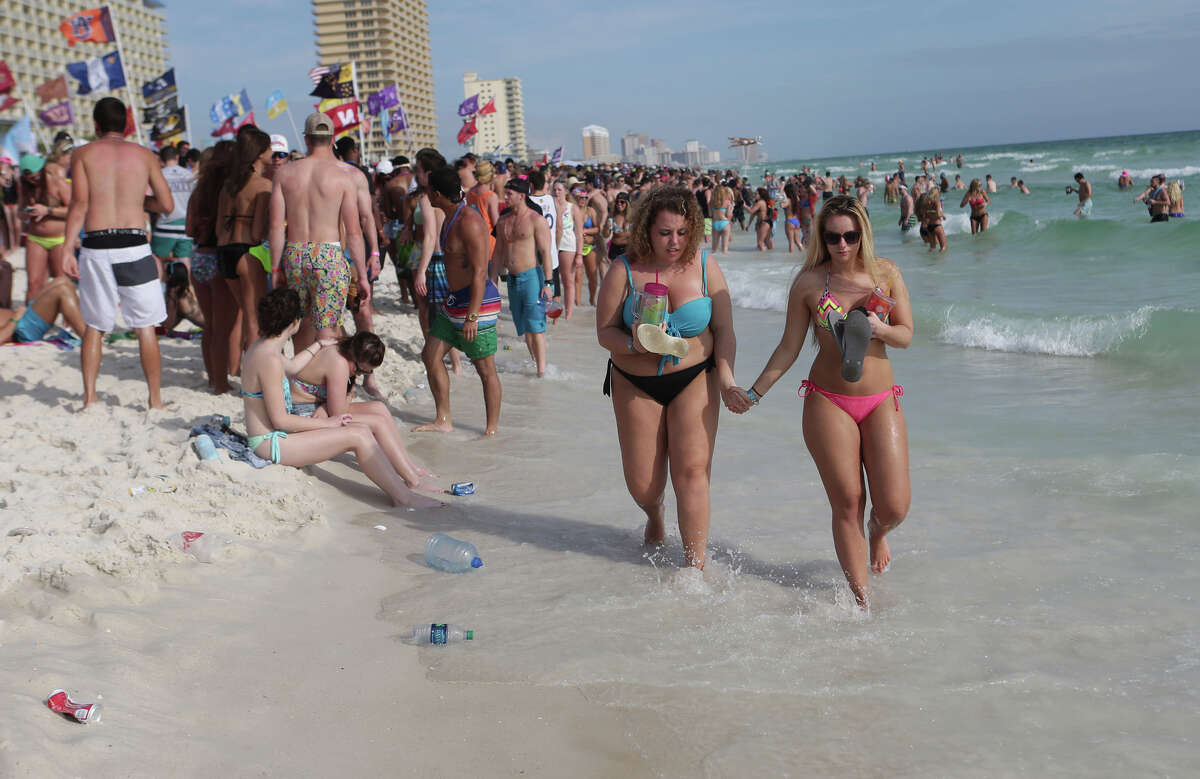 Party goers fill the sand behind Club La Vela and Spinnaker Beach Club during the fourth week of spring break on Wednesday, March 25, 2015, in Panama City Beach, Fla. (AP Photo/News Herald, Heather Leiphart) MANDATORY CREDIT