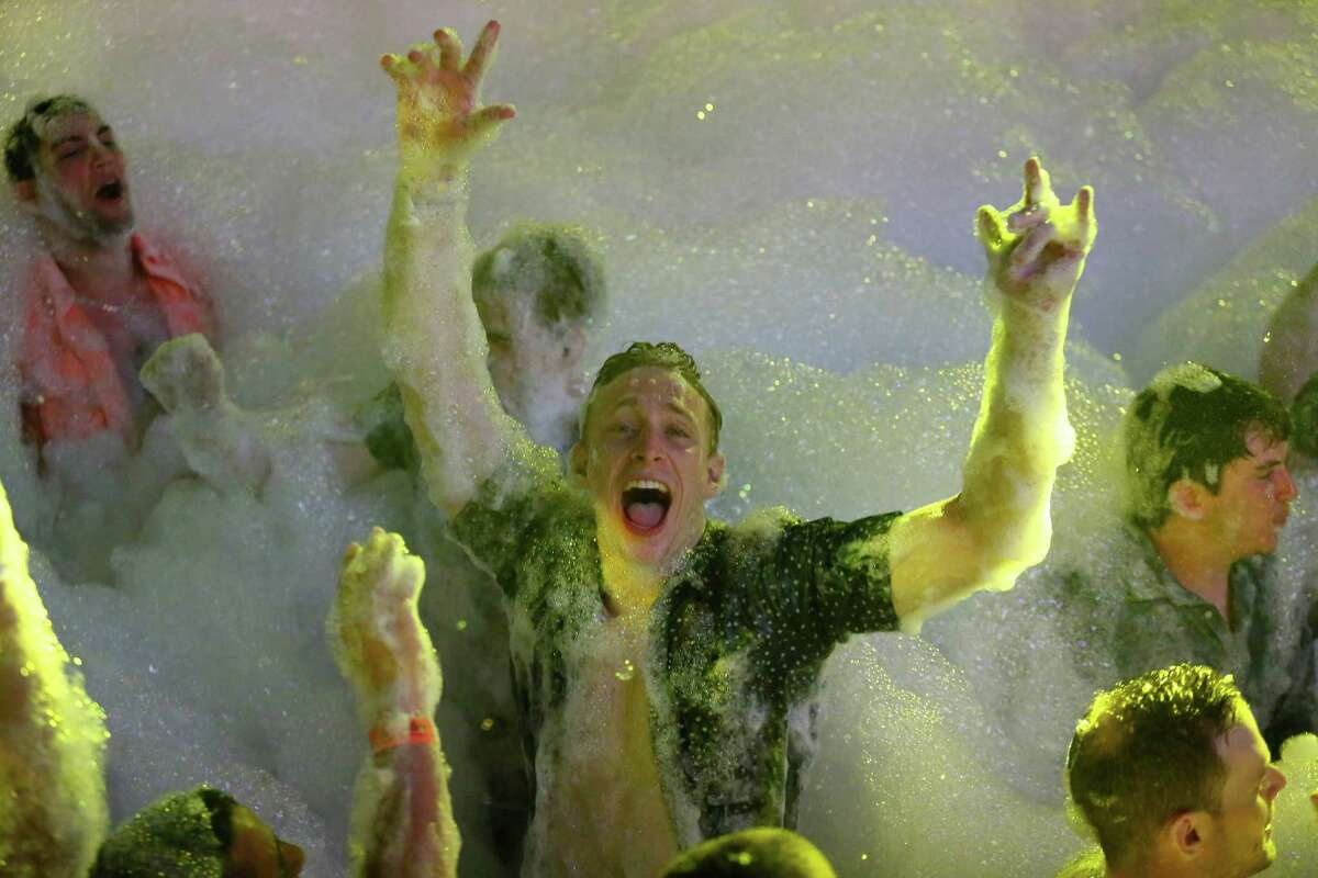 Spring Breakers are covered in foam at The City nightclub in the Caribbean resort city of Cancun, Mexico, early Monday, March 16, 2015. Cancun continues to be one of the top foreign destinations for U.S. college students to spend Spring Break.