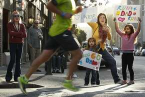 (R-L) Six-year-old Teah Edeza, her mother Carissa and her three-year-old sister Liza cheer for the mother's cousin Junior during the Rock 'n' Roll Half Marathon, Sunday, March 29, 2015, in San Francisco, Calif. Carissa's husband came in a few minutes behind Junior.