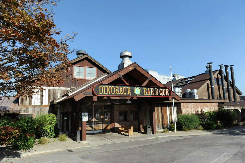 Dinosaur Bar-B-Que is seen at 377 River St. on Wednesday, Sept. 24, 2014, in Troy, N.Y. A New York City law firm alleged in March 2015 that Dinosaur has been cheating workers at its New York locations out of wages. (Cindy Schultz / Times Union)