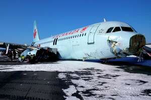 Air Canada passengers believe jet hit power line before crashing - Photo