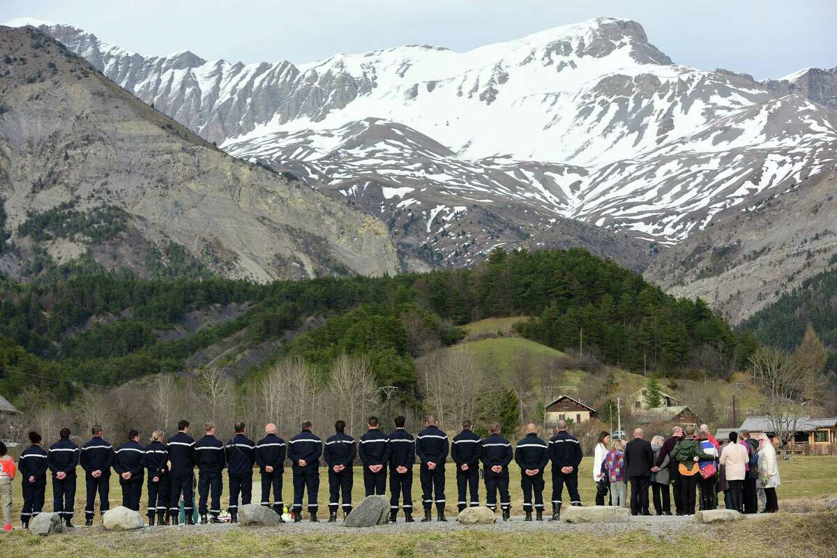 LA VERNET, FRANCE - MARCH 28: Relatives stand at a monument to honour the victims of Germanwings flight 4U9525 in front of the mountains near the crash site on March 26, 2015 in Le Vernet, France. France. French authorities confirmed that Andreas Lubitz was alone in the cockpit during the rapid descent of flight 4U9525 until it crashed into mountains in southern France four days ago, killing all 150 people on board. Lubitz hid signs of illness and it is thought he acted deliberately in steering the aircraft to its destruction. (Photo by Thomas Lohnes/Getty Images) *** BESTPIX ***