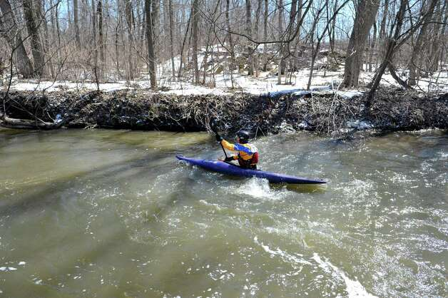 A kayaker paddles along the Anthony Kill during the 42nd Annual Tenandeho Whitewater Derby on Sunday, March 29, 2015, in Mechanicville, N.Y.   (Paul Buckowski / Times Union) Photo: PAUL BUCKOWSKI / 10030872A