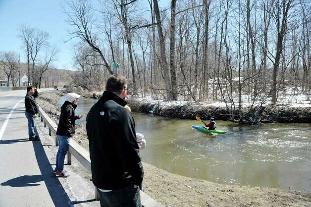 Spectators cheer on the paddlers making their way along the Anthony Kill  during the 42nd Annual Tenandeho Whitewater Derby on Sunday, March 29, 2015, in Mechanicville, N.Y.   (Paul Buckowski / Times Union) Photo: PAUL BUCKOWSKI / 10030872A