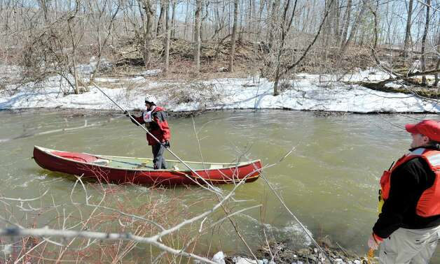 Scott Stepenuck from Ballston Spa canoe poles down the Anthony Kill  during the 42nd Annual Tenandeho Whitewater Derby on Sunday, March 29, 2015, in Mechanicville, N.Y.  Stepenuck was not competing in the race but was the sweep boat so that rescuers along the banks of the river knew that all other boats were through once the sweep boat came by.   (Paul Buckowski / Times Union) Photo: PAUL BUCKOWSKI / 10030872A