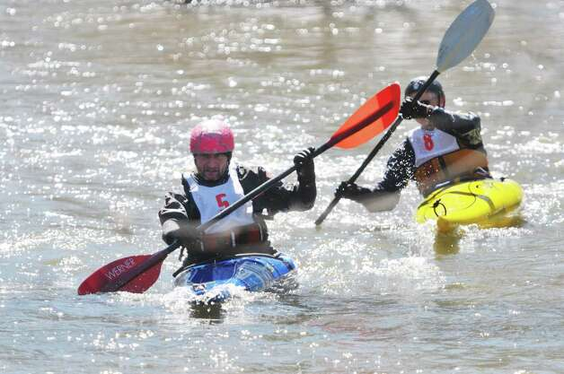 Kayakers, Mike Stoll, left, and Jim Ernst make their way down the Anthony Kill during the 42nd Annual Tenandeho Whitewater Derby on Sunday, March 29, 2015, in Mechanicville, N.Y.   (Paul Buckowski / Times Union) Photo: PAUL BUCKOWSKI / 10030872A