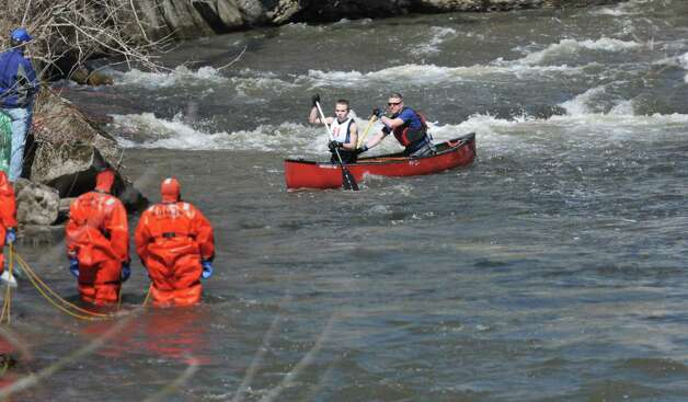 Dan Morris, left, and his father, Robert Morris, both from Saratoga Springs, navigate through the rapids in the Anthony Kill during the 42nd Annual Tenandeho Whitewater Derby on Sunday, March 29, 2015, in Mechanicville, N.Y.  Rescue personnel were stationed at points along the river to help any paddlers who capsized.   (Paul Buckowski / Times Union) Photo: PAUL BUCKOWSKI / 10030872A