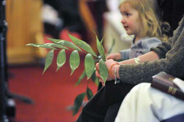 Parishioners hold palms during Palm Sunday service at First Church in Albany on Sunday, March 29, 2015, in Albany, N.Y.   (Paul Buckowski / Times Union) Photo: PAUL BUCKOWSKI / 00031217A