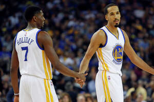 Point guard Shaun Livingston (right) has ably guided the second unit, which often includes shooting guard Justin Holiday.