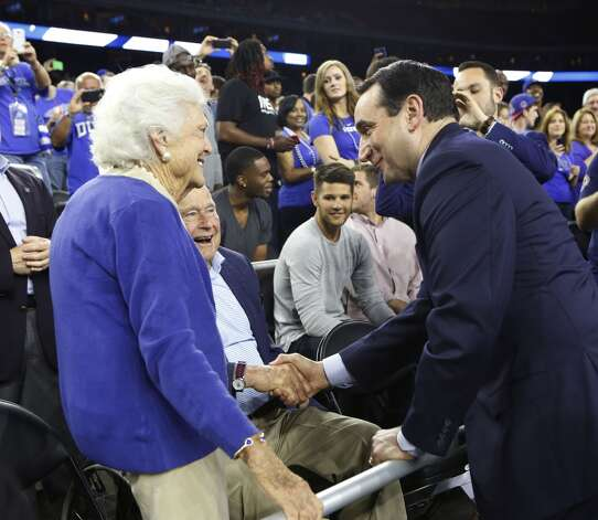 Duke's Coach Mike Krzyzewski greets George and Barbara Bush before the South Regional Final between Duke and Gonzaga at NRG Stadium Sunday, March 29, 2015, in Houston.  Photo: Houston Chronicle