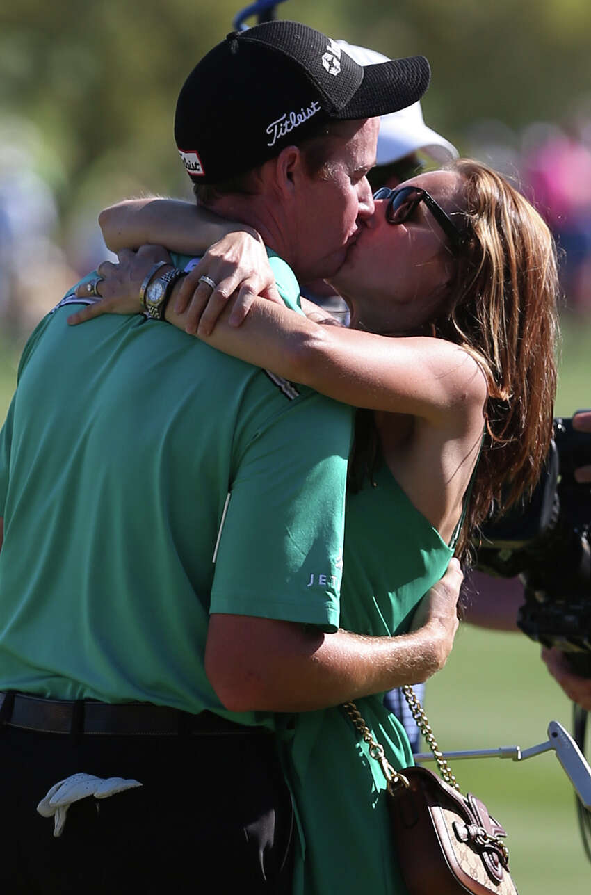 Jimmy Walker of Boerne, kisses his wife, Erin, after winning the Valero Texas Open at TPC San Antonio, Sunday, March 209, 2015. Walker shot an 11-under to take the $1.1 million purse. Coming at second with an 7-under was Jordan Spieth of Dallas and Billy Horschel came in third at 4-under.