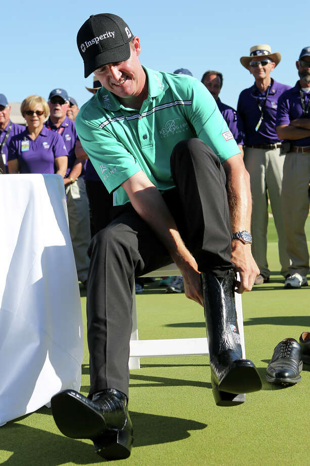 Jimmy Walker of Boerne, TX, tries on the championship boots after winning the Valero Texas Open at TPC San Antonio on Sunday, March 29, 2015. Walker was 11 under for the tournament.   MARVIN PFEIFFER/ mpfeiffer@express-news.net Photo: Marvin Pfeiffer, By Jerry Lara, San Antonio Express-News / Express-News 2015