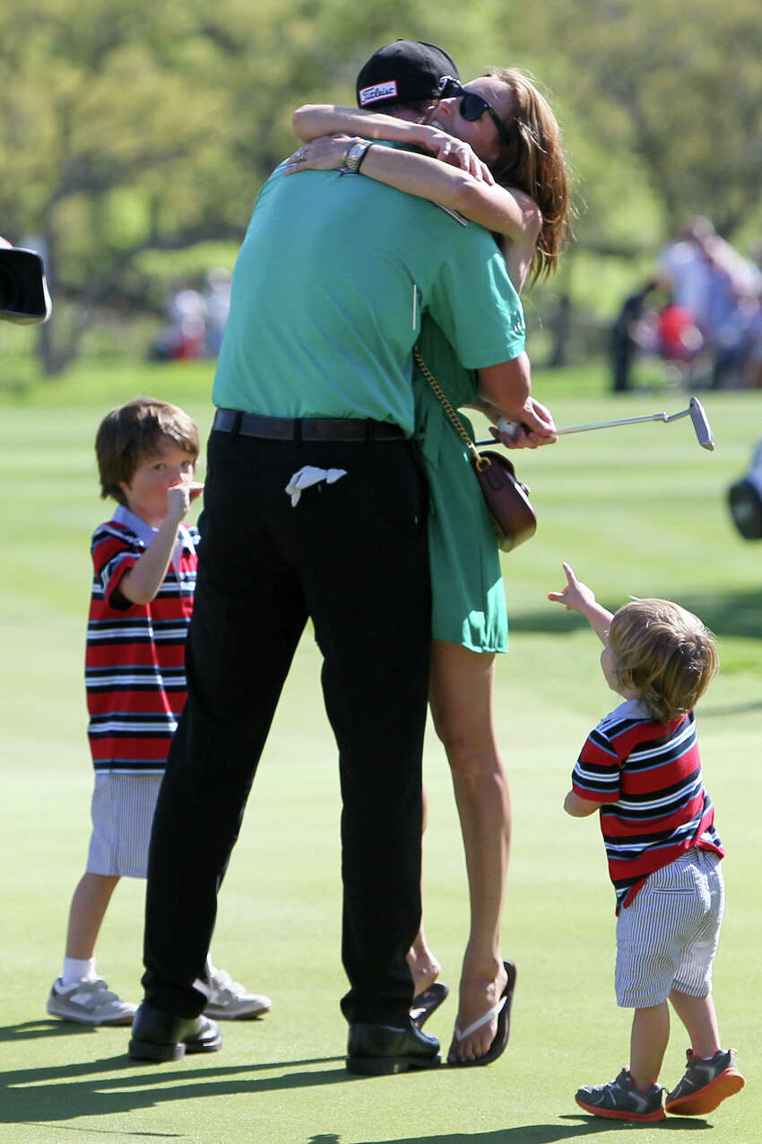 Jimmy Walker of Boerne, TX is greeted by his wife, Erin and sons Mclain (left), 4, and Beckett, 2, on the 18th hole after winning the Valero Texas Open at TPC San Antonio on Sunday, March 29, 2015. MARVIN PFEIFFER/ mpfeiffer@express-news.net