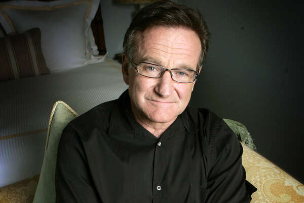 In this June 15, 2007 file photo, actor and comedian Robin Williams poses for a photo in Santa Monica, Calif. Williams died Monday, Aug. 11, 2014, in an apparent suicide at his San Francisco Bay Area home. (AP Photo/Reed Saxon, File)