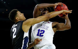 Justise Winslow (12), playing in his hometown of Houston, tries to power through Angel Nunez.
