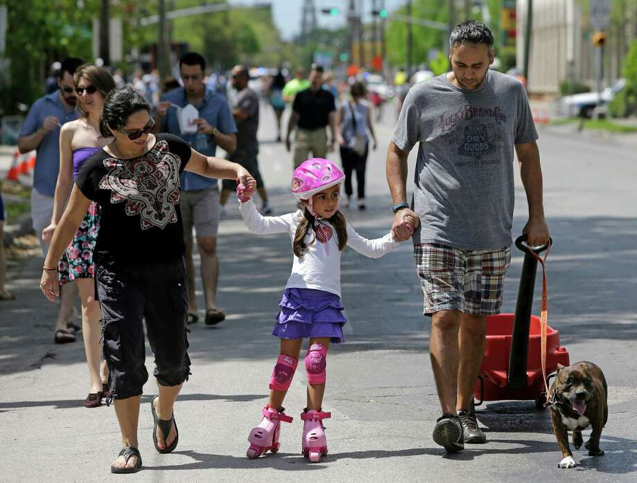 The turnout at the Sunday Streets on Westheimer shows that Houstonians are hungry to experience the city outside of their cars. Photo: Melissa Phillip, Houston Chronicle / © 2015  Houston Chronicle
