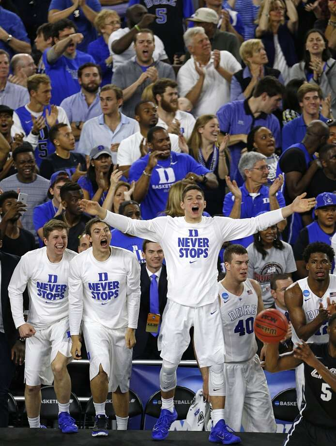 Duke Blue Devils guard Grayson Allen center, celebrates on the sidelines during the second half of the NCAA South Regional final game against the Gonzaga Bulldogs at NRG Stadium Sunday, March 29, 2015, in Houston. ( James Nielsen / Houston Chronicle ) Photo: Houston Chronicle