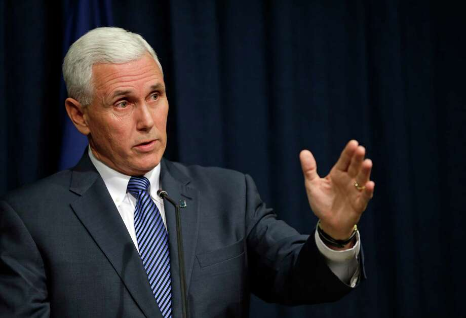 Indiana Gov. Mike Pence holds a news conference at the Statehouse in Indianapolis, Thursday, March 26, 2015.  Pence has signed into law a religious objections bill that some convention organizers and business leaders have opposed amid concern it could allow discrimination against gay people. (AP Photo/Michael Conroy) Photo: Michael Conroy, STF / AP