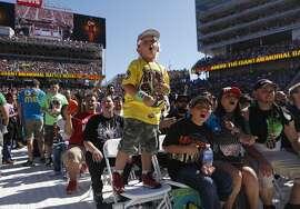 Alex Valencia, 6, of El Sobrante cheers on his favorite wrestlers during WrestleMania 31at Levi's Stadium in Santa Clara, Calif. Sunday, March 29, 2015.