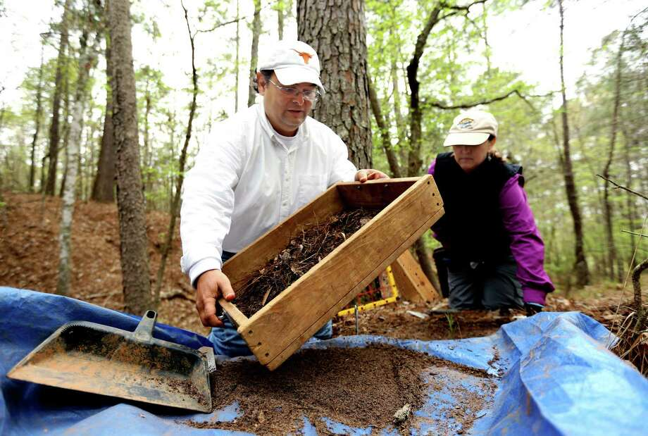 San Antonio archaeologist Sergio Iruegas, left, and Julie Vickers, a volunteer and donor, dig Thursday for artifacts along a segment of El Camino Real de los Tejas National Historic Trail in San Augustine. Photo: Gary Coronado, Staff / © 2015 Houston Chronicle