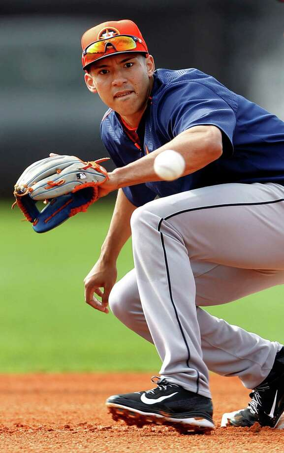 Carlos Correa played well in spring training but needs more seasoning, as he's yet to appear in a game above Class A. Photo: Karen Warren, Staff / © 2015 Houston Chronicle