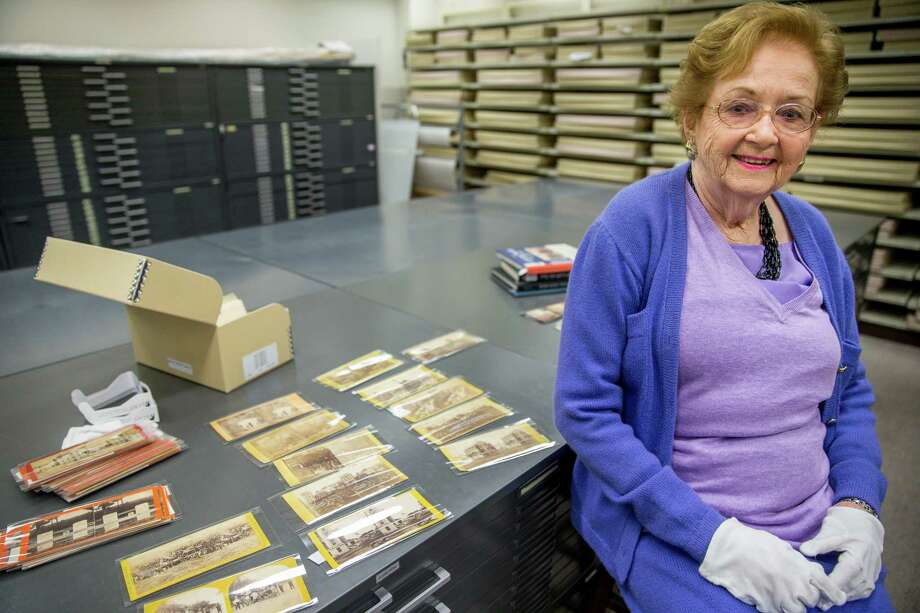 Texas stereoscopic photography collector Robin Stanford poses for a photograph next to some of her rare Civil War-era stereoscopic photographs at the Library of Congress on Friday, March 27, 2015, in Washington. Stanford has sold the Library of Congress some of her private collection, including a set of very rare photos of pre-Civil War slave life on a South Carolina plantation, and images from Fort Sumter just after it was seized by the Confederates in April 1861. Stereoscopic photography creates the illusion of three-dimensional depth from two similar two-dimensional photographs taken next to each other. (AP Photo/Andrew Harnik) Photo: Andrew Harnik, STF / AP