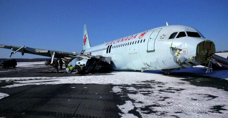 The Air Canada Airbus A-320 lost its landing gear on landing, and one of its two engines was broken off along with the nose cone as it skidded to a stop. Photo: Uncredited, HONS / The Transportation Safety Board