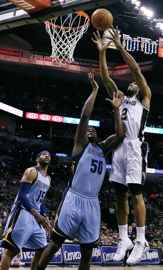 San Antonio Spurs' Kawhi Leonard grabs for a rebound over Memphis Grizzlies' Zach Randolph as Vince Carter looks on during first half action Sunday March 29, 2015 at the AT&T Center. Photo: Edward A. Ornelas, Staff / San Antonio Express-News / © 2015 San Antonio Express-News