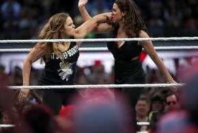 UFC Women's Bantamweight Champion Rhonda Rousey hits Stephanie McMahon during WrestleMania at Levi's Stadium in Santa Clara, Calif., on Sunday, March 29, 2015.