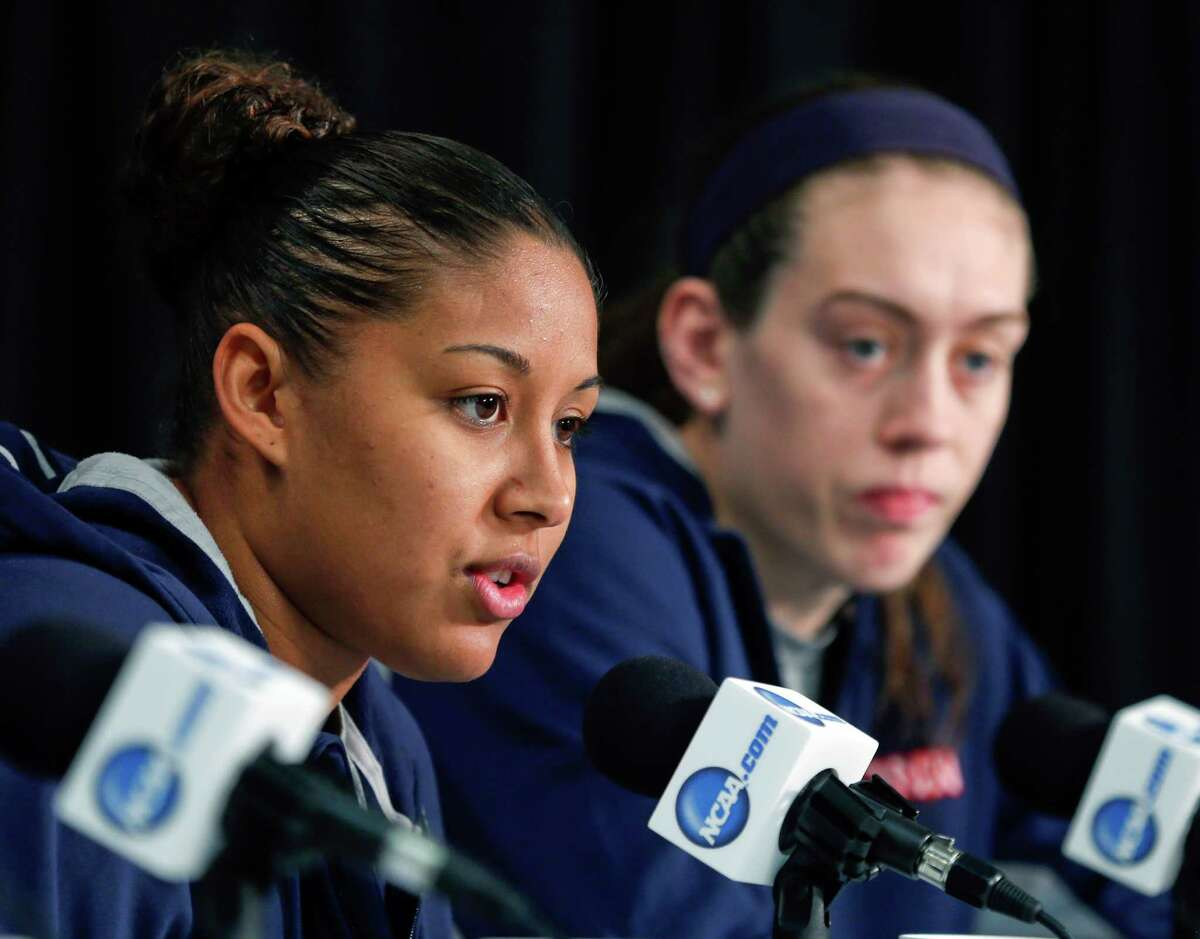 Connecticut forward Kaleena Mosqueda-Lewis (23) speaks during a news conference for a women's college basketball regional final game in the NCAA Tournament on Sunday, March 29, 2015, in Albany, N.Y. Breanna Stewart is seated right. UConn plays Dayton on Monday. (AP Photo/Mike Groll) ORG XMIT: NYMG105