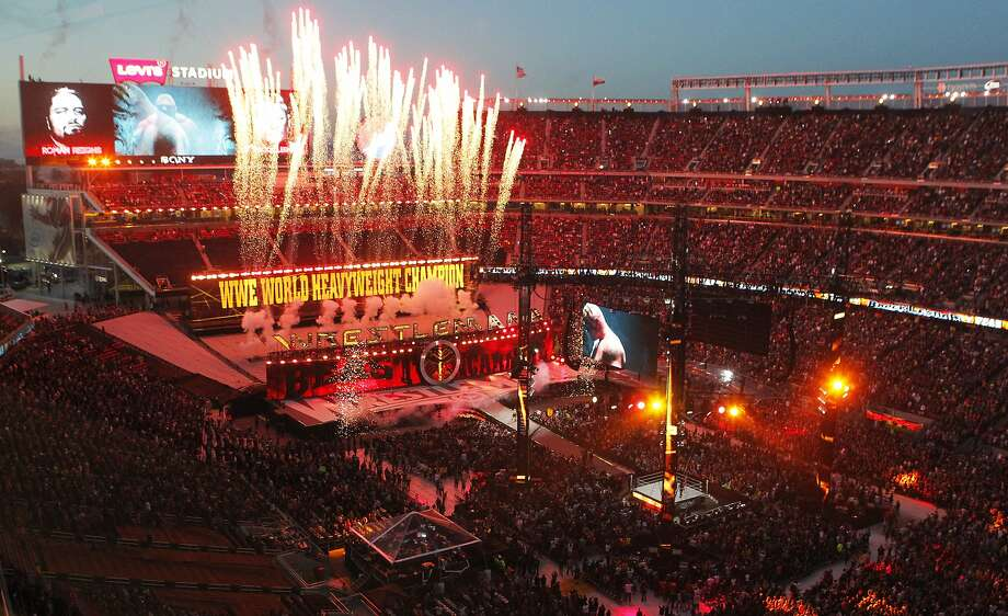 Fireworks shoot into the sky as WWE heavyweight champion Brock Lesnar enters the ring during WrestleMania 31at Levi's Stadium in Santa Clara, Calif. Sunday, March 29, 2015. Photo: Jessica Christian, The Chronicle