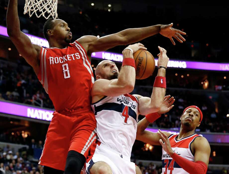 Rockets center Joey Dorsey defends against the Wizards' Marcin Gortat (4) in Sunday's victory. Photo: Alex Brandon, STF / AP
