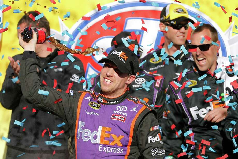 Denny Hamlin returns to Victory Lane for the fifth time at venerable Martinsville Speedway. Photo: Steve Helber, STF / AP